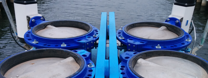 image of 4 large blue turbines used for wave energy measurements
